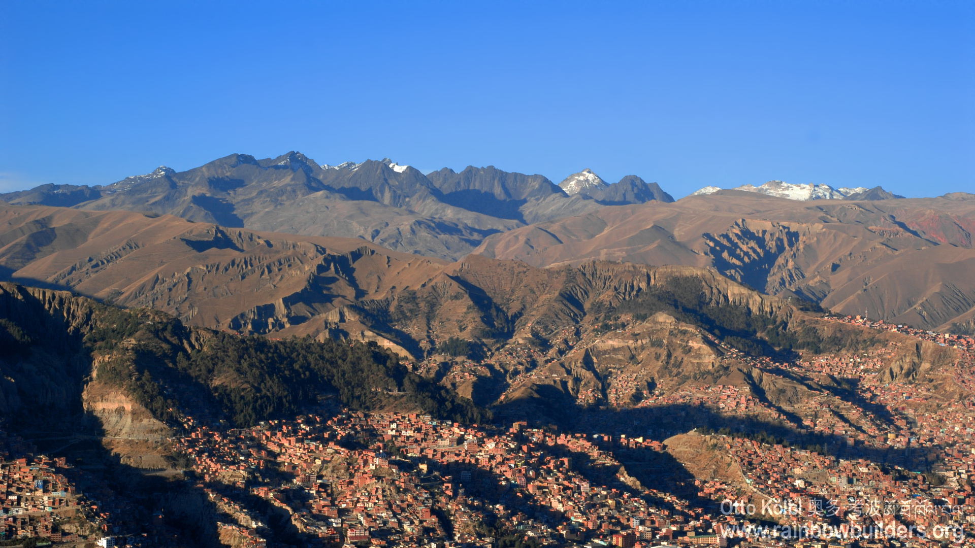 La Paz, the capital city of Bolivia, is surrounded by barren hills and high mountains. These houses are at an altitude of more than 3800 meters above sea level.