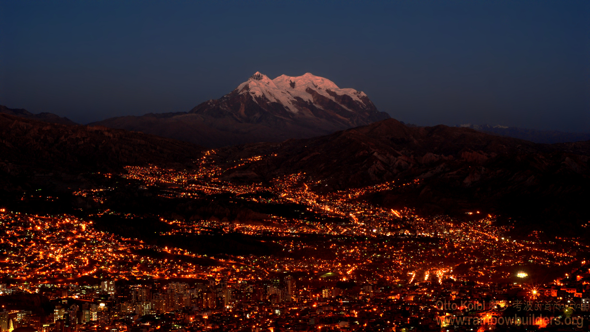 La Paz after sunset, with the Illimani in the background, taken from El Alto.