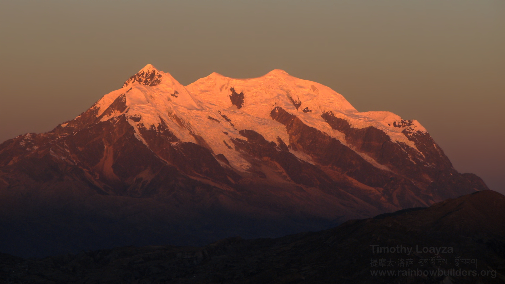 The Illimani, the mountain towering over La Paz (Bolivia), gets the last sun rays of the day.