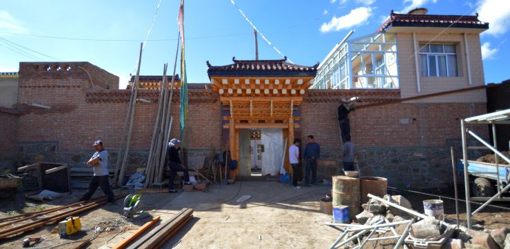 Tibetans building a new house in the traditional style of the region