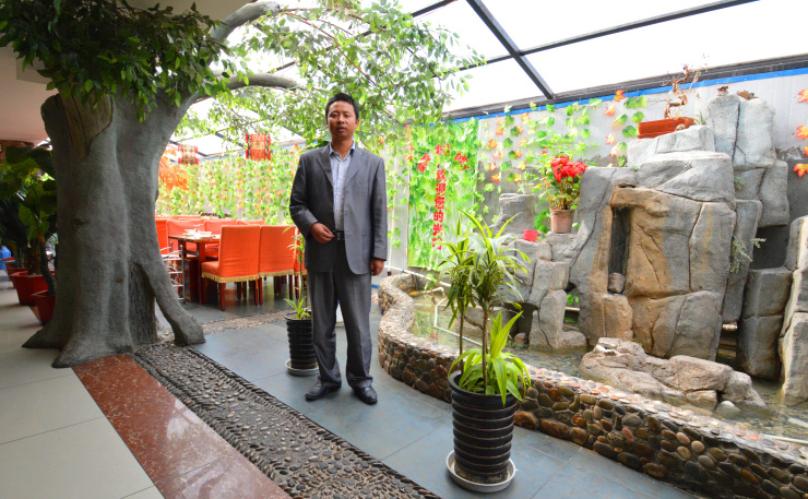 Tibet: Hot pot restaurant and its manager in downtown Hezuo, Gannan Tibetan Autonomous Prefecture, Gansu province.