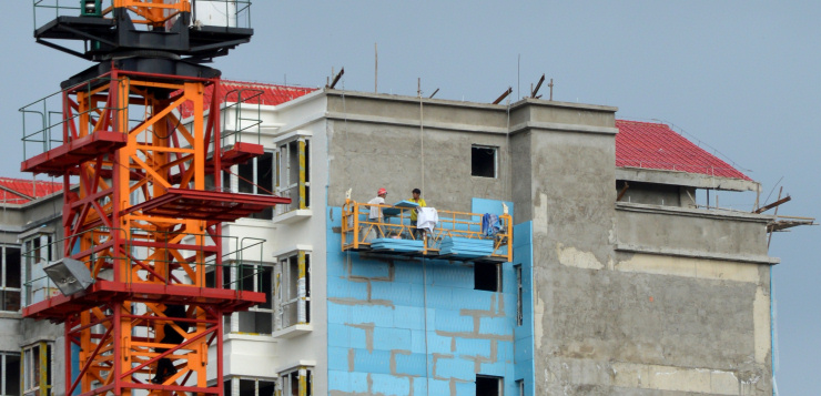 Tibet: Thermic insulation panels are fitted on a residential building in Hezuo, Gansu province.