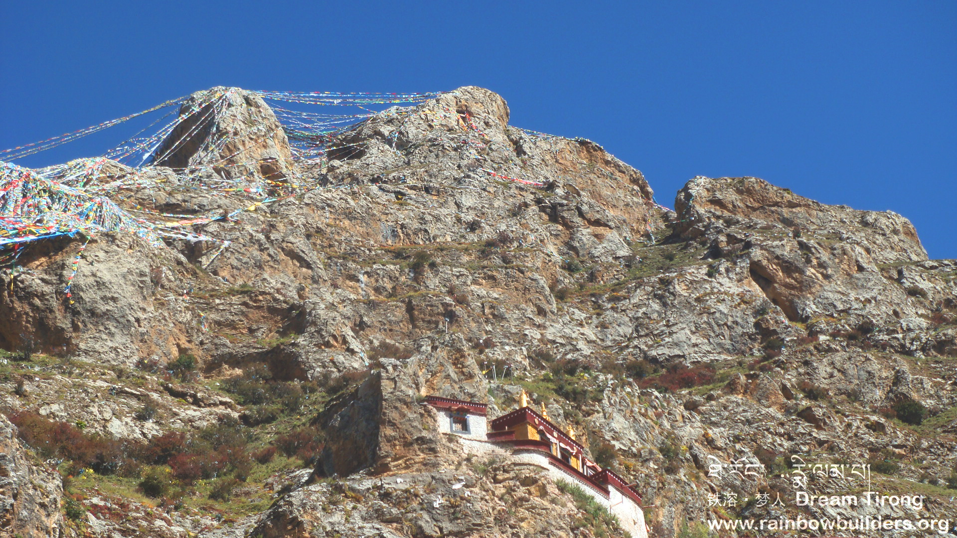 The prayer flags on the cliffs over the monastery spread the wishes of the pilgrims all over the world and beyond.