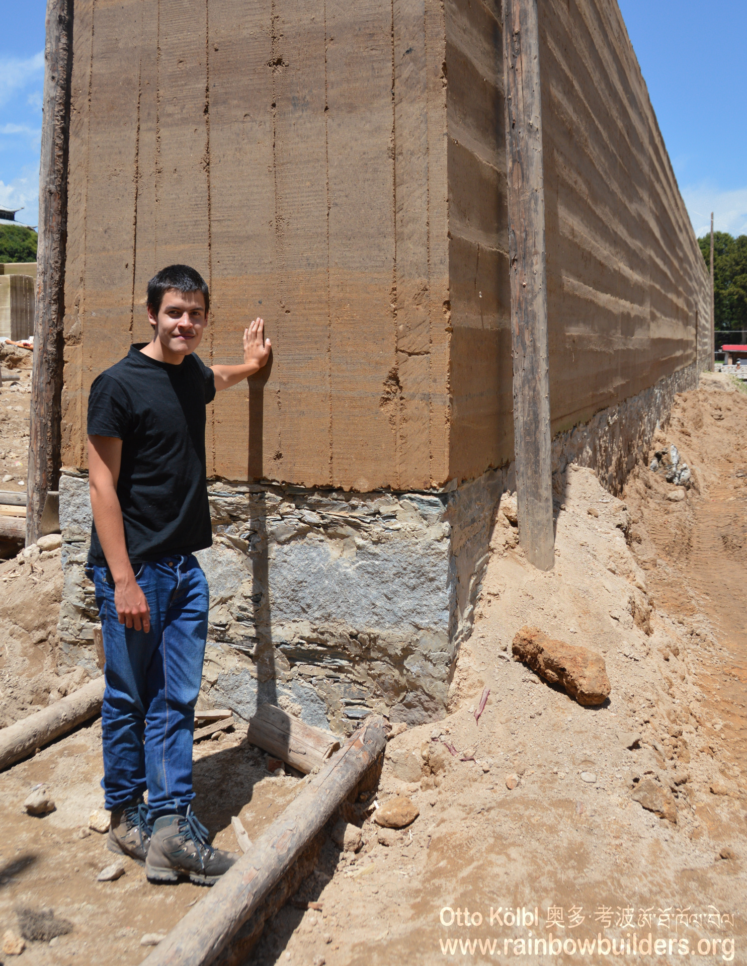 Timothy Loayza leaning on the perimeter wall which is more than one meter thick. This is necessary in a region where earthquakes are not uncommon.