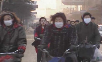 Chinese people often wear face masks to protect against dust and pollution.
