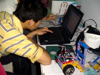 A Chinese middle school student prepares for a robotic contest. In Chinese schools, the children do not only learn by heart.