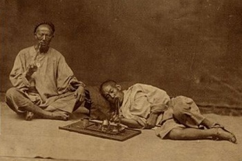 Two opium smokers in Shanghai, around 1870. Photo: Virtual Shanghai.