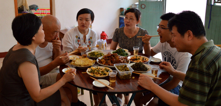 China: A Chinese urban family takes a meal in a one-table-restaurant in a small village near Baoji, Shaanxi. Such activities are a typical entry-level activity for farmers to get additional income.